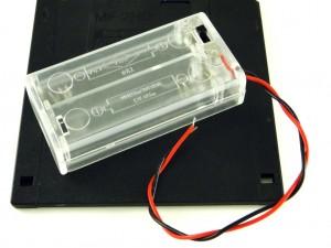 Корпус для двух батарей AA, закрытый с выключателем, прозрачный